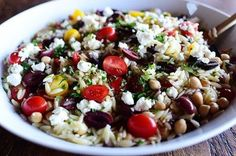 I love a good orzo salad, and this is one of my favorites because it's tangy and fresh and there are approximately fourteen million fun ingredients…so it goes with pretty much everythin…