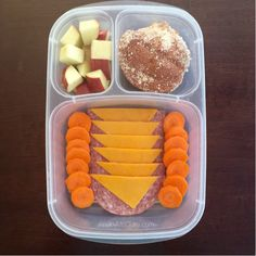 Simple school lunch! Salami slice halves, cheese, apples, carrot coins, and an udi's GF muffin in an EasyLunchboxes container!