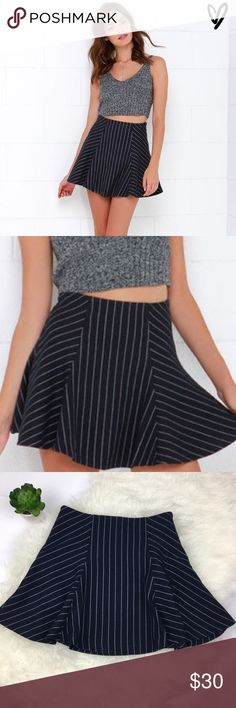 JOA Cosmopolitan Cutie Striped Mini Skirt Navy blue pinstriped skirt from JOA! Excellent condition. Side zip. Fully lined. Medium weight felted twill fabric. Fitted waist flows into a full flare. Sold at Lulu's. True to size. Ships same day from a smoke free home. No trades 🎀 Lulu's Skirts Circle & Skater