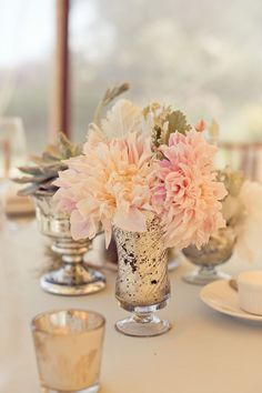 white, pale dusty pinks with pale warm pinks, frosty greens using peonies, dahlias and garden roses