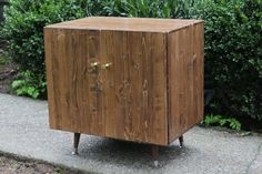 Handcrafted Mid Century Modern media cabinet is ideal for a smaller living room or apartment. Store all of your electronics in this elegant