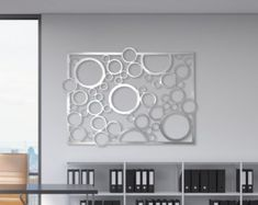 Valerie  This is a limited edition custom laser cut aluminum decorative panel in a contemporary design. Inspired by the jewelry, this panel adds a unique feature.  This forms an excellent focal point of any room. It can be installed tight to a wall or offset as desired to create a floating effect with shadowing.  This product is also available as:  Medium: 2-1 1/2 in length by 2-1 1/2 in height by 1/16 thick. 2-1 1/2 in length by 2-1 1/2 in height by 1/8 thick.  Large: 3-0 in length by 3-0…
