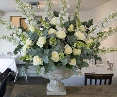 Large arrangements next to top table filled with bright flowers