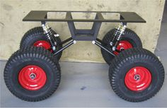 Swing-Arm kit rolling chassis with red steel wheels by Baja Wagon.