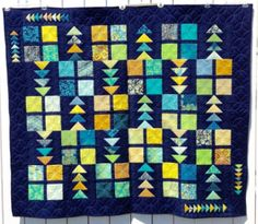 """Carol Connelly shared this quilt appropriately named, """"Follow My Lead"""". EASY to make using GO! Square Die and GO! Triangles! #accuquilt #quiltingideas #quilts #easyquilts"""