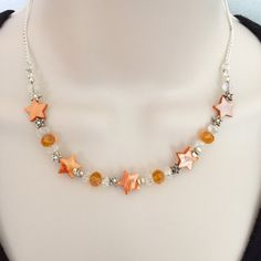 A personal favourite from my Etsy shop https://www.etsy.com/uk/listing/220388749/orange-mother-of-pearl-star-and-glass