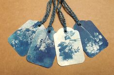 Cyanotype gift tags with indigo dyed thread.