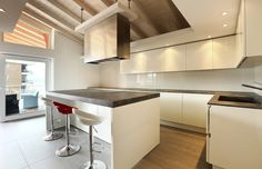 Modern kitchen with high gloss white lacquer cabinets and island with black soapstone countertops Ikea Kitchen Design, Modern Kitchen Cabinets, Kitchen Cabinet Design, Modern Kitchen Design, Kitchen Interior, Kitchen Decor, Kitchen Designs, Kitchen Ideas, Diy Concrete Countertops