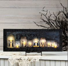 Halloween decor idea but with real mason jars for the mantle etc