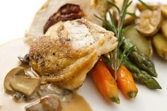 Sun-dried tomato stuffed chicken breast and roasted baby potatoes with mushroom sauce from Chef Marco Pierre White.