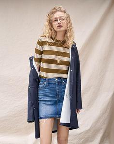 madewell ribbed sweater top worn with the step-hem jean skirt, stutterheim® mosebacke raincoat + spinning pendant necklace.