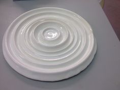Ceramics - inspired by soundwaves. This is actually the vibration of a ceramic plate being smashed made into 3D form.