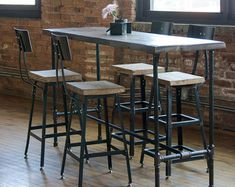 Reclaimed wood community bar restaurant table is well sanded and ...