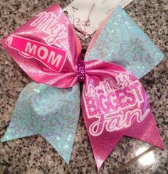 Bows by April - FAN CLUB My Mom is My BIGGEST Fan Mint Sequins and Pink Mystique Cheer Bow, $18.00 (http://www.bowsbyapril.com/fan-club-my-mom-is-my-biggest-fan-mint-sequins-and-pink-mystique-cheer-bow/)