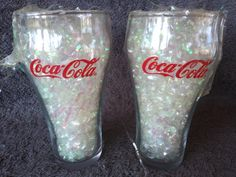 Available is a set of 2 clear glass coca-cola drinking glasses. Both are clean with no damage. Each measures about 6 tall x 3 at the rim. These were displayed by a collector for many years. Coca Cola Drink, Cola Drinks, Rainbow Brite, Cheap Apartment, Salt And Pepper Set, Vintage Table, 1990s, Christmas Fun, Clear Glass