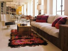 Platform sofa and textured rug.