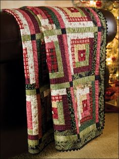 Beautiful Christmas quilt-I love the button on this quilt