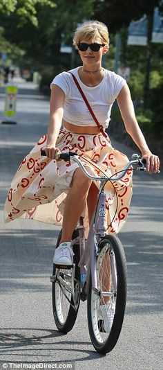 Lady-like: Although she was wearing a skirt, the pretty blonde positioned herself properly above the bike so as to avoid any embarrassing moments
