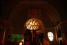 clips of scary movies projected on the wall at this halloween theme wedding at the museum of man in balboa park in san diego