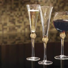 Set of 2 Gold Diamond Balloon Flutes from Midnight Velvet®. Exquisite glassware for a special toast, these glasses are trimmed in 24K Gold and faceted crystals.