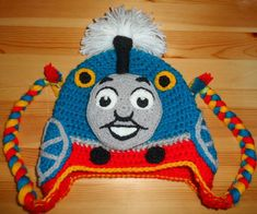 My little nephew is crazy about trains and I really wanted to make him a train hat, but I couldn't find a pattern I liked, so I decided to make one of my own.I'm not very experienced when it comes to stitching and crochet, but I'll try my best to explain how I made it. For the hat you will need: blue, grey, red, yellow, black and white wool crochet hooks 3mm, 4mm and 5mm sewing needle washable fabric marker pillow filling I tried to write the pattern in US terms, for the UK conver...