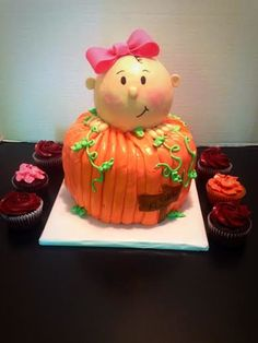 Buttercream finished pumpkin with little baby girl made out of...