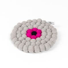 Trivet - Round - Grey & Pink. This soft, stain & heat resistant trivet, that brings colour to your table setting. These unique trivets are made of 100% high quality wool.