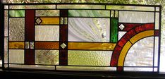 Custom stained and leaded glass transom window
