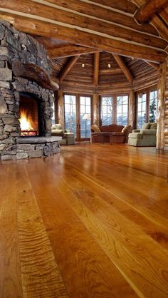 Carlisle Wide Plank Floors Cherry Solid Wood Floors in a Colorado Living Room. The quality of a Carlisle floor is matched only by that of the customer experience.