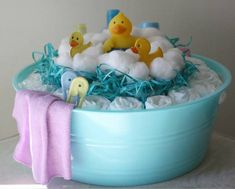 Super Cute Yellow Rubber ducky for Shower gift.  Blue tub, Rolled up diapers topped with easter grass and a rubber ducky. Can stick in any other bath items of your choice