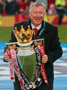 FINAL HOME GAME Manchester Uniteds manager Sir Alex Ferguson holds the premier league trophy after his last home game in charge of the club, their English Premier League soccer match against Swansea City, at Old Trafford Stadium, Manchester, England, Sunday May 12, 2013. (AP Photo/Jon Super) GALLERY:Sir Alex Fergusons final home game