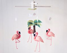 This mobile features 4 elegant, detailed flamingos surrounding a beautiful palm tree on a wooden hanger (available in either natural wood color