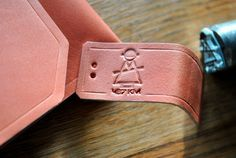 Embosed leather. Label for the leather clutch.