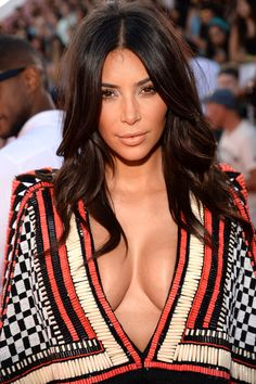 Kim Kardashian was glowing from head to . . . décolletage, but we expect nothing less from the bronzed beauty.