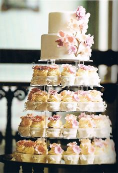 Cupcake tower. White with pink flowers. I like the top two layers then cupcakes.