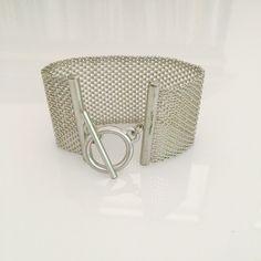 Silver mesh bracelet Some wear by the closure as shown. N/A Jewelry Bracelets