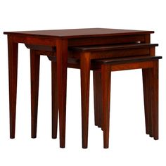 Set of Chic Danish Rosewood Nesting Tables   From a unique collection of antique and modern nesting tables and stacking tables at https://www.1stdibs.com/furniture/tables/nesting-tables-stacking-tables/