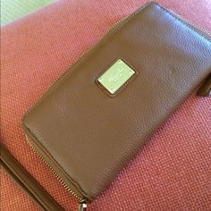 Kenneth Cole New York zipper wallet NWOT New Kenneth Cole zipper wallet never used camel pebble leather Kenneth Cole Accessories