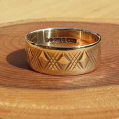 A vintage 9K wide band yellow gold by Timehonouredtreasure on Etsy, £130.00