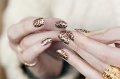 Metallics are hot for AW12 - get the look with these fabulously shiny leopard print nails.