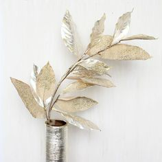 Get metallic artificial foliage for your DIY holiday centerpieces like this gorgeous ivory glittered magnolia leaf spray. Add stunning glam and pizzazz to any DIY bouquet or winter arrangement with th
