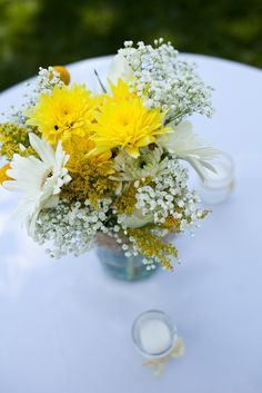 Centerpieces in mason jars. Could do different colored flowers.