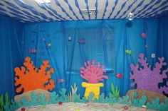table clothes over windows or create awings, streams on the ceiling or over door windows, styrofoam coral around room