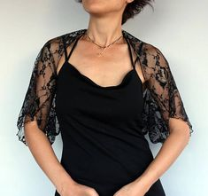 Black lace bolero, shoulder stole coverup Its made with lightweight, elastic French lace with light silver and gold patterns on it. One size fitting into S to M A shawl scarf, shoulder stole made with the same fabric is also available. Its seen at the 6th pic. and can be purchased from :