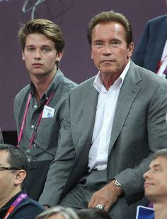 Actor Arnold Schwarzenegger and his son Patrick Schwarzenegger seen watching the USA vs Spain Men's Basketball Olympic Finals during the London 2012 Summer Olympics Games.