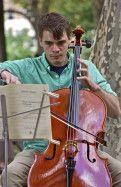 Strong bow, stronger strings; Rittenhouse Square Fine Arts Show; Philadelphia, Pennsylvania, USA.  September 2013.