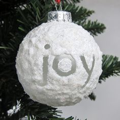 DIY Snowball Ornaments.. this would be adorable with kids names and dates on it