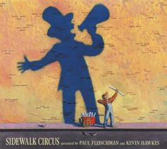 Sidewalk Circus by Paul Fleischman and Kevin Hawkes. A young girl watches as the activities across the street from her bus stop become a circus.