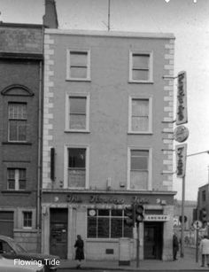 """The Flowing Tide on Abbey Street, early Still going strong Dublin Pubs, Dublin Street, Dublin City, Dublin Ireland, Old Pictures, Old Photos, Images Of Ireland, Stone Facade, Ireland Homes"