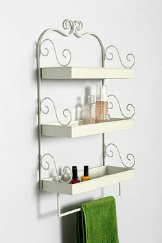 triple-tiered wall shelf / urban outfitters. Perfect for odds & ends like makeup & nail polish! #BestRoomEver